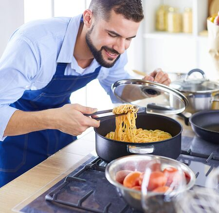 Photo for Man preparing delicious and healthy food in the home kitchen - Royalty Free Image