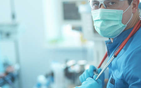 Photo for Male surgeon on background in operation room - Royalty Free Image
