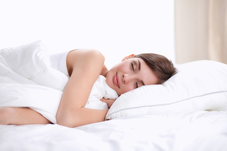 Photo pour Beautiful girl sleeps in the bedroom, lying on bed. - image libre de droit