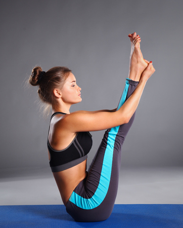 Foto de Portrait of sport girl doing yoga stretching exercise . - Imagen libre de derechos