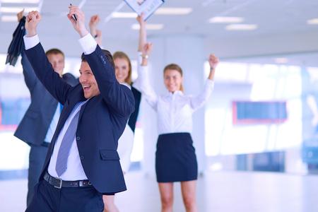 Photo pour Business team celebrating a triumph with arms up  . - image libre de droit