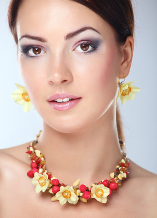 Photo for Portrait of young beautiful brunette woman in beads . - Royalty Free Image