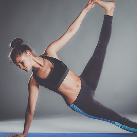 Photo pour Portrait of sport girl doing yoga stretching exercise - image libre de droit