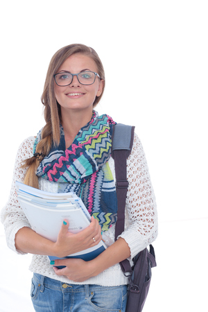 Portrait of young student woman holding exercise books. Student. University