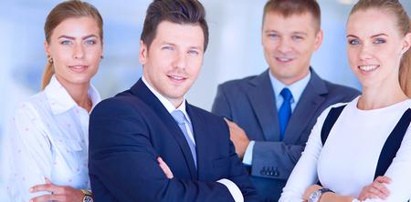 Foto de Happy business team showing thumbs up in office. Happy business team - Imagen libre de derechos