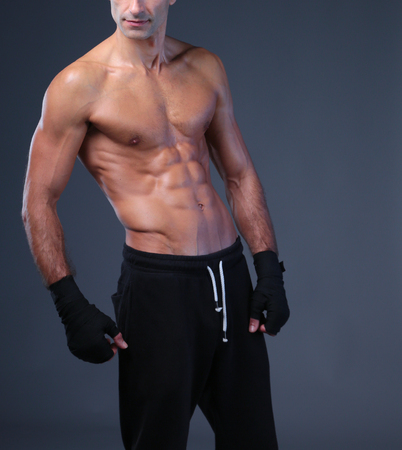 Foto für portrait of hand wrapping half nude boxer. - Lizenzfreies Bild