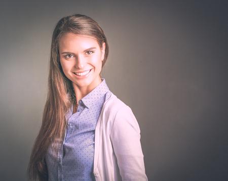 Photo pour Portrait of a businesswoman against dark background. Woman smiling. - image libre de droit