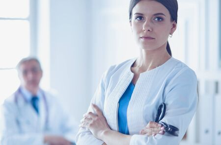 Photo for Two doctors in a consulting room in hospital. Female doctor looking at the camera. - Royalty Free Image