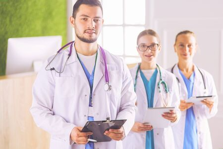 Photo for Group of doctors and nurses standing in the hospital room - Royalty Free Image