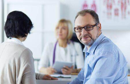 Photo pour Smiling medical doctor and patient. Health care - image libre de droit