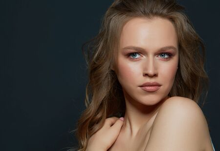 Photo pour Beautiful womans face with tan. clean skin - isolated on black - image libre de droit
