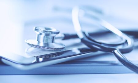 Medical equipment: stethoscope and tablet on white background. Medical equipment