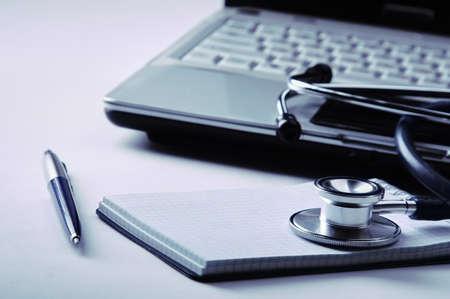 Medical stethoscope , laptop, folder on the desk