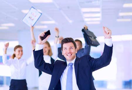 Photo pour Business team celebrating a triumph with arms up - image libre de droit
