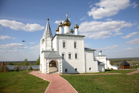 Beautiful summer landscape with an orthodox temple and the blue sky.