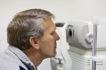 mature man checks sight on the special device