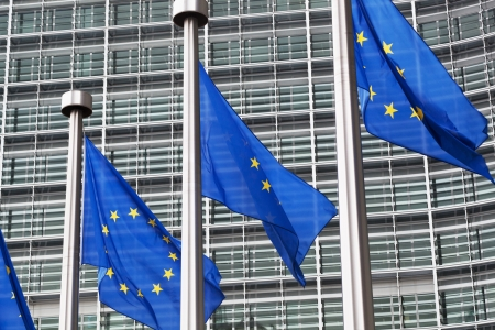 European Union flags against the European Parliament building