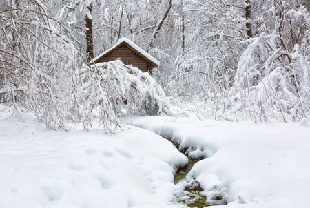 Winter landscape with a house and a river