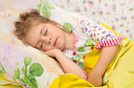 Sweet Dream. Little girl asleep with a smile on your face