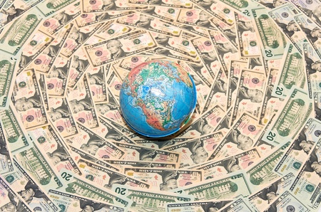 Background of the money. The background of U.S. dollars. Globe in U.S. dollars. Global Economy