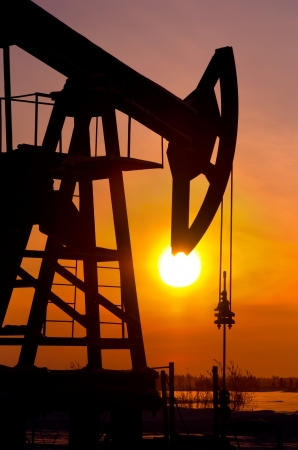 Oil pump rocker close to sunrise background