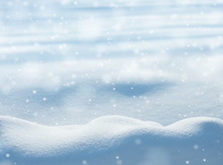 Natural winter background with snow drifts and falling snowの写真素材