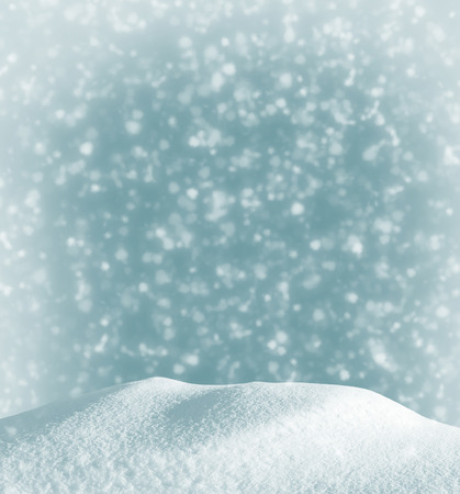 Christmas background with a snowdrift and the falling snow