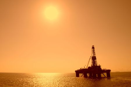 Silhouette of an oil drilling rig. Coast of Brazil.