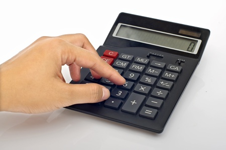 Woman hand push calculator button on the table