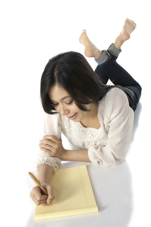 Pretty asian woman write on the floor, isolated over white background