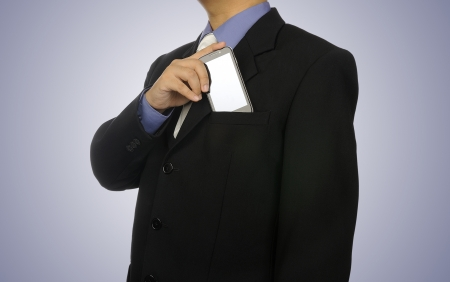Man in business suit holding cellphone  You can put your design on the phone