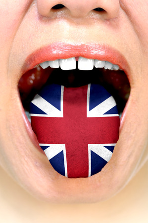 Conceptual of fluent speaking english. Woman show her tongue with english flag.