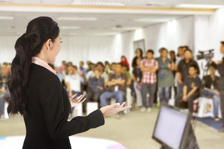 Foto de Speaker at conference and presentation. Audience at the conference hall - Imagen libre de derechos