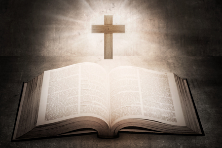 Photo for Open holy bible with wooden cross in the middle. Christian concept - Royalty Free Image