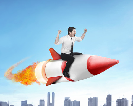 Photo for Image of asian business man flying ride rocket - Royalty Free Image