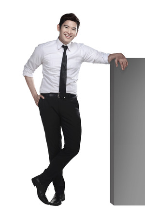 Photo pour Asian business man lean on the block isolated over white background - image libre de droit