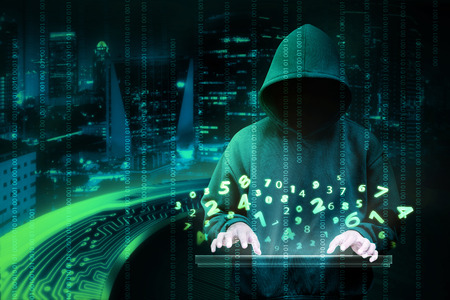 Photo pour Man in hoodie shirt is hacker. Computer security concept - image libre de droit
