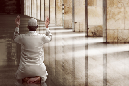Religious muslim man praying inside the mosqueの写真素材