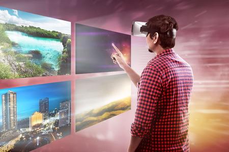 Photo pour Young asian man wear VR headset get into virtual reality world - image libre de droit