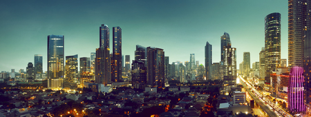Foto de Building and traffic of Jakarta city, Indonesia - Imagen libre de derechos