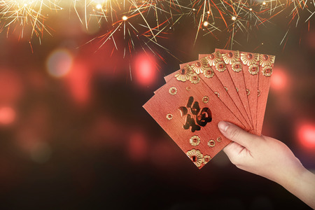 Hand holding red envelope. Chinese new year concept