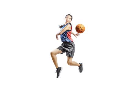 Foto de Pretty asian woman playing basketball posing isolated over white background - Imagen libre de derechos