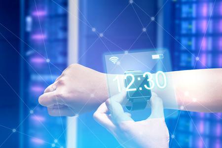 Photo pour Male hand with smartwatch check the time. Digital technology concept - image libre de droit