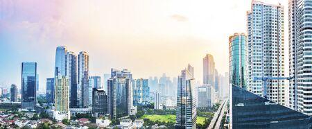 Foto de Panoramic Jakarta skyline with urban skyscrapers in the afternoon. Jakarta, Indonesia - Imagen libre de derechos