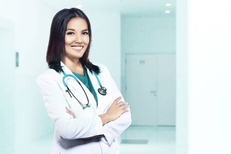 Photo pour Asian doctor woman with stethoscope standing in the hospital - image libre de droit