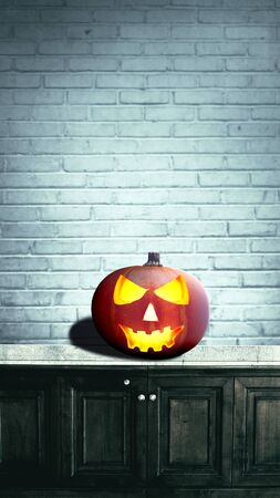 Foto de Jack-o-Lantern on the table with a brick wall background. Stories template for Halloween - Imagen libre de derechos