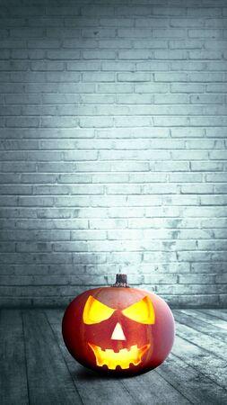 Foto de Jack-o-Lantern on wooden floor with brick wall background. Stories template for Halloween - Imagen libre de derechos