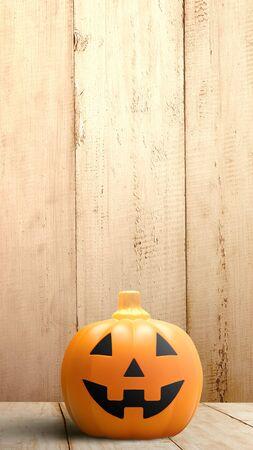 Foto de Jack-o-Lantern on wooden floor with wooden wall background. Stories template for Halloween - Imagen libre de derechos