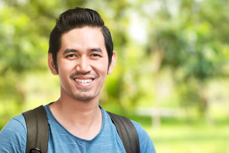 Photo pour Asian man with smile on his face. World Smile Day - image libre de droit