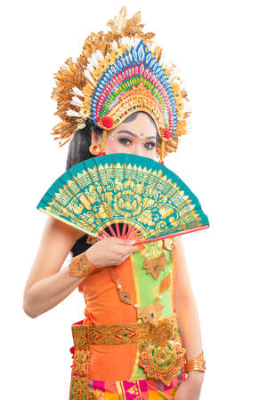 Photo pour Asian woman dancing Balinese traditional dance isolated over white background - image libre de droit